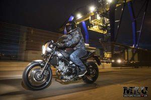 Suzuki SV650X motorcycle side view with rider